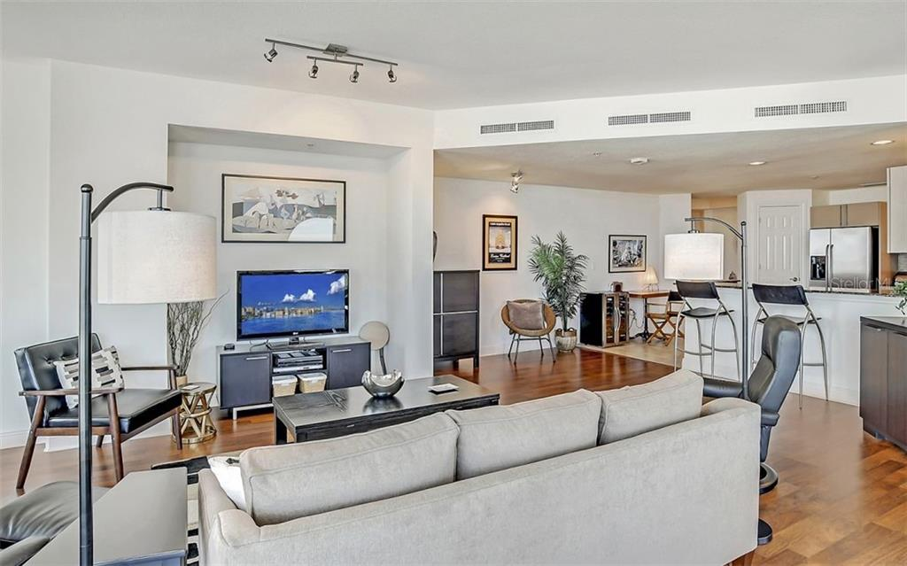 Gleaming floors give warmth to the room - Condo for sale at 1771 Ringling Blvd #1110, Sarasota, FL 34236 - MLS Number is A4474683