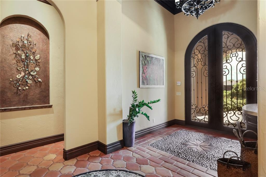 The entry to the wine room and large office is directly off the foyer. - Single Family Home for sale at 4925 Topsail Dr, Nokomis, FL 34275 - MLS Number is A4475116