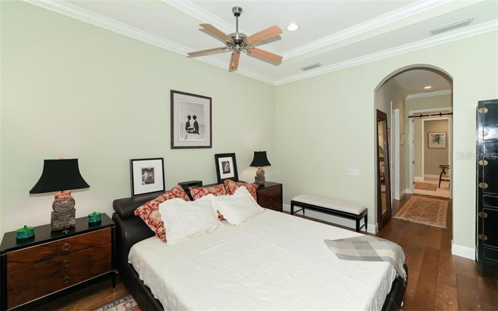 Master suite with two walk in customer closets and garden bath - Single Family Home for sale at 3538 Trebor Ln, Sarasota, FL 34235 - MLS Number is A4475545