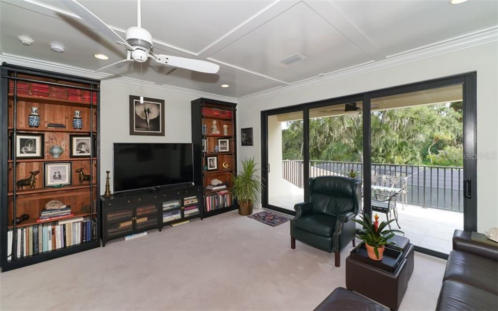 Second floor family room, north facing balcony. - Single Family Home for sale at 3538 Trebor Ln, Sarasota, FL 34235 - MLS Number is A4475545
