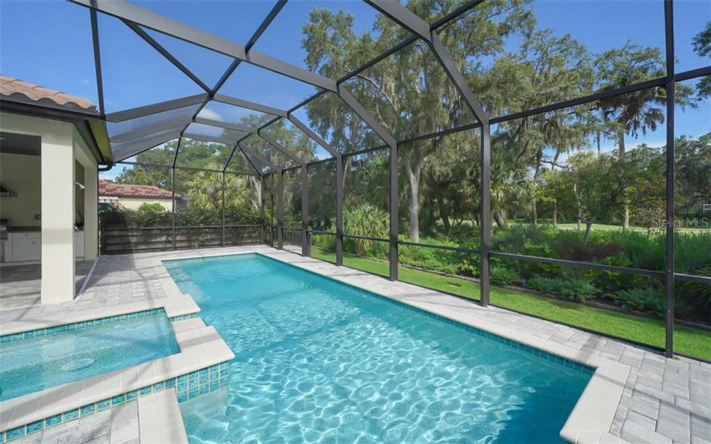Lap pool with splash area and separate spa - Single Family Home for sale at 3538 Trebor Ln, Sarasota, FL 34235 - MLS Number is A4475545