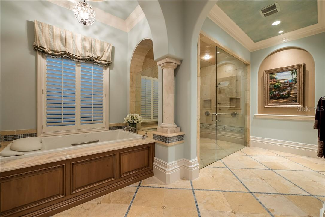 Soaking Tub and Walk-In Shower for Ultimate Relaxation - Single Family Home for sale at 8499 Lindrick Ln, Bradenton, FL 34202 - MLS Number is A4475594