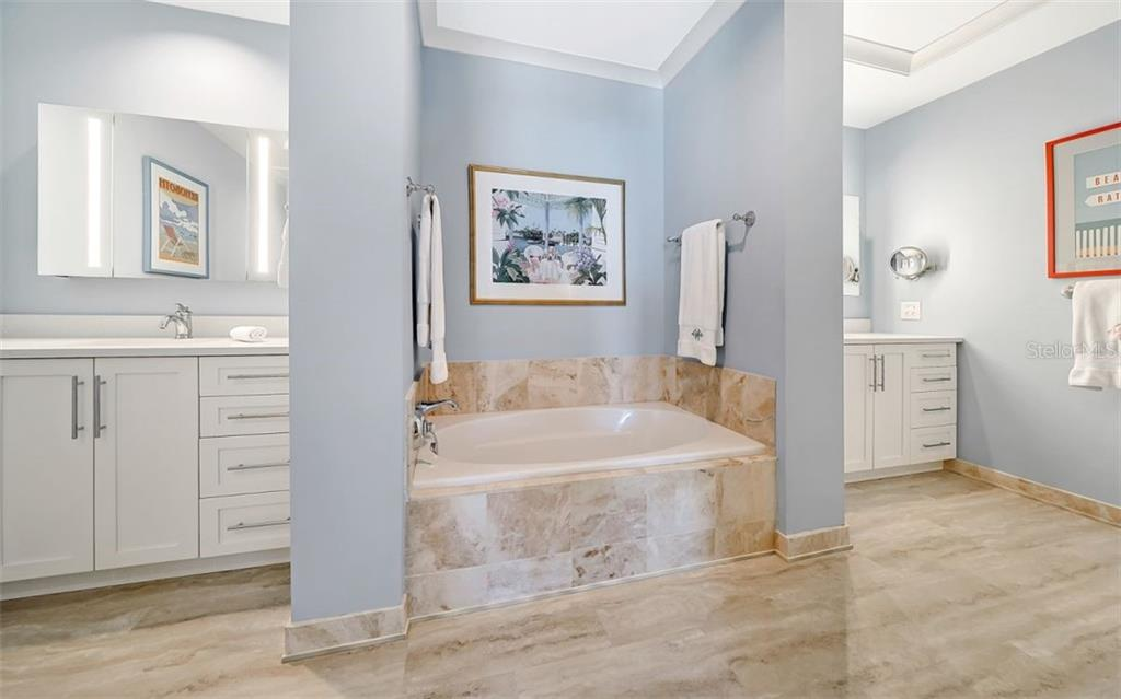 The master bath has his and her areas and a soaking tub - Condo for sale at 1350 Main St #1601, Sarasota, FL 34236 - MLS Number is A4478753