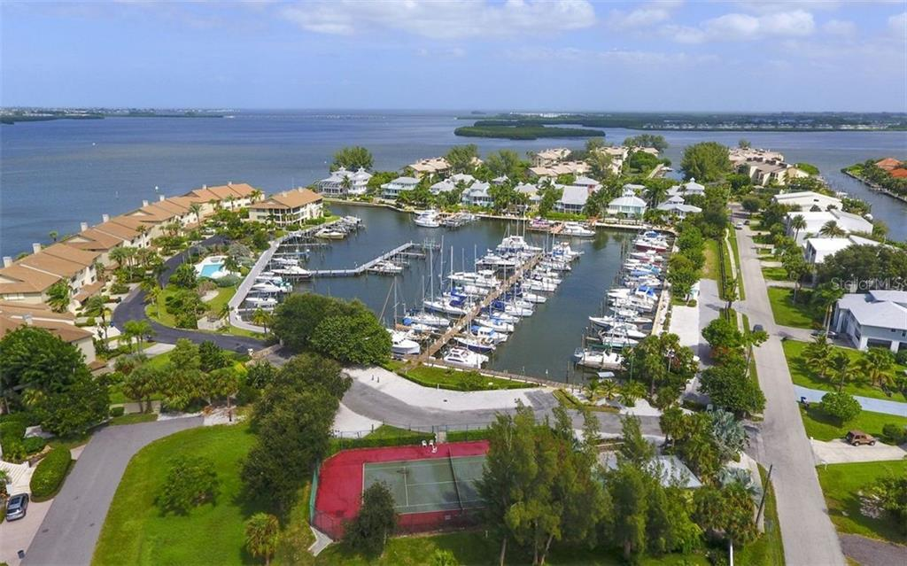 Deeded boat slip with 10,000 lbs. lift - Single Family Home for sale at 12901 42nd Ter W, Cortez, FL 34215 - MLS Number is A4478977