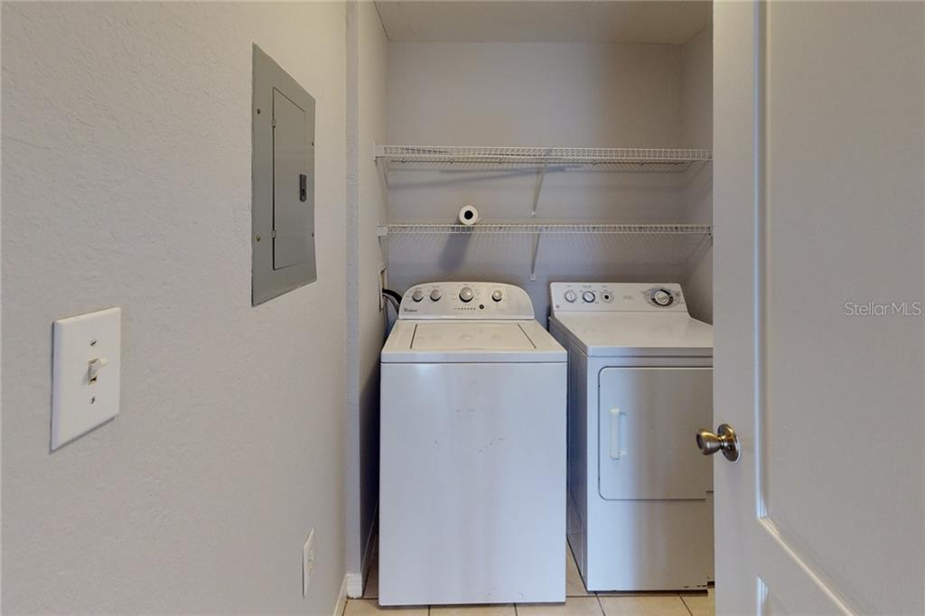 Laundry room off of entrance. - Condo for sale at 4118 Central Sarasota Pkwy #1621, Sarasota, FL 34238 - MLS Number is A4479192