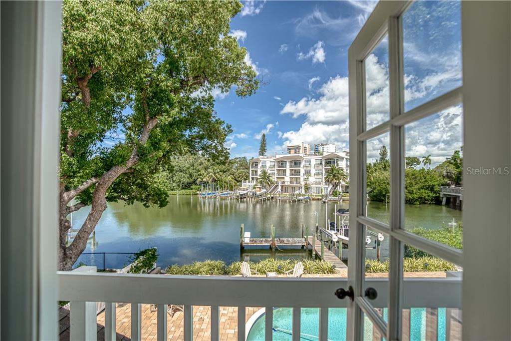 View of Hudson Bayou from Master Bedroom Balcony - Single Family Home for sale at 1595 Bay Point Dr, Sarasota, FL 34236 - MLS Number is A4479218