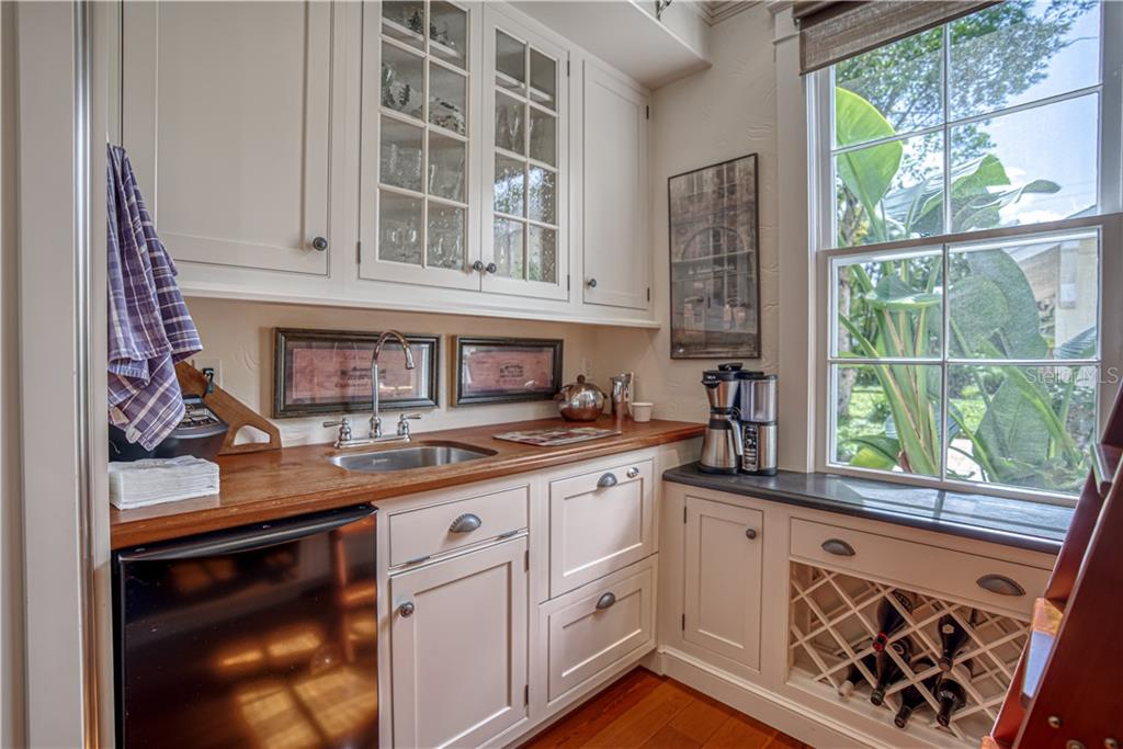Wet Bar with Ice Machine, Dishwasher Drawer, and Custom Wine Rack - Single Family Home for sale at 1595 Bay Point Dr, Sarasota, FL 34236 - MLS Number is A4479218