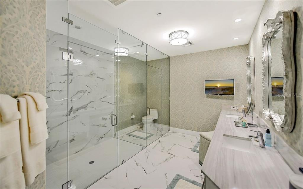 Glass enclosed walk-in shower and water closet - Condo for sale at 1155 N Gulfstream Ave #1701, Sarasota, FL 34236 - MLS Number is A4480090