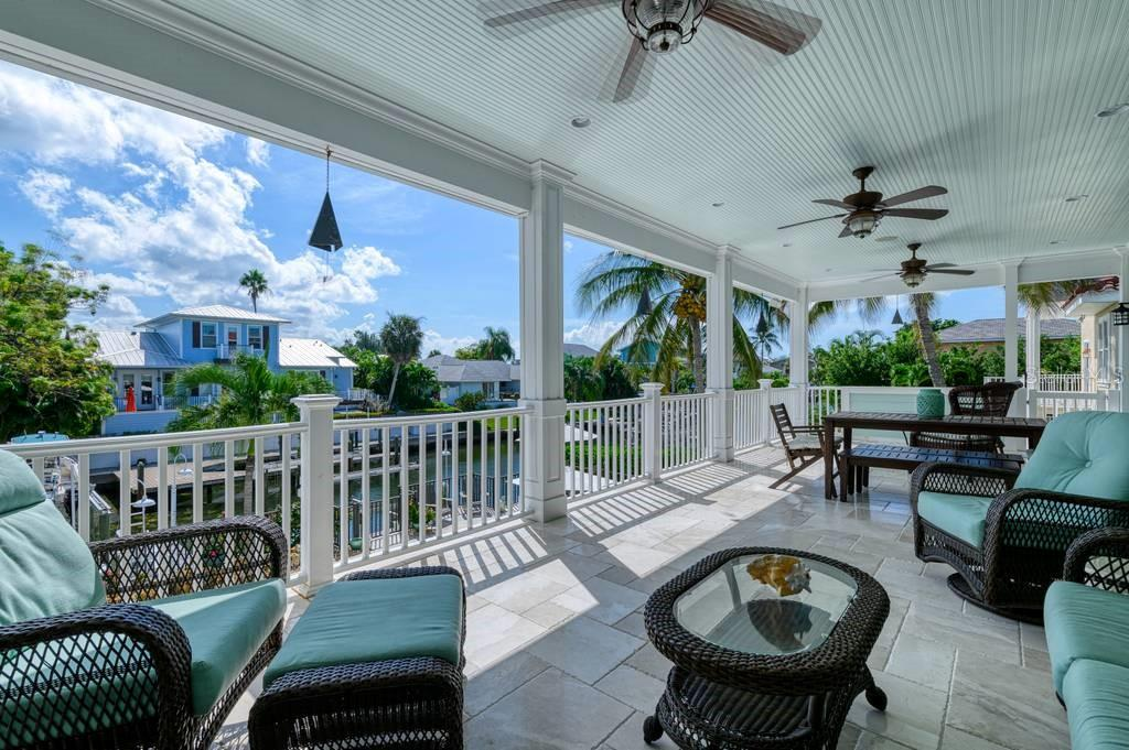 Second floor balcony/patio. - Single Family Home for sale at 718 Key Royale Dr, Holmes Beach, FL 34217 - MLS Number is A4480381