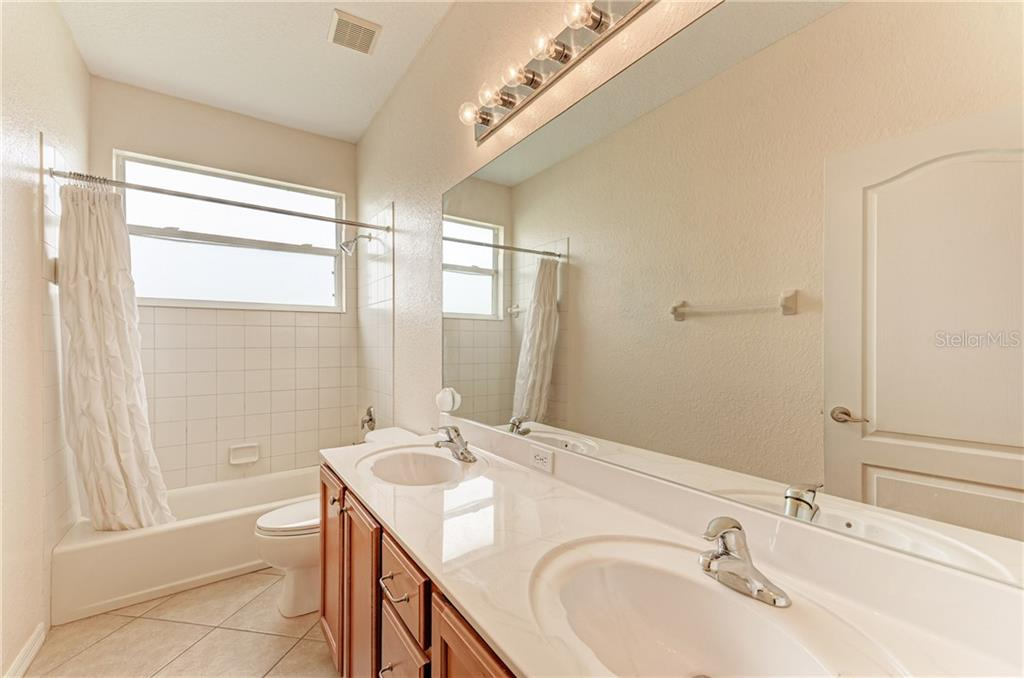 3rd bathroom upstairs - Single Family Home for sale at 7118 68th Dr E, Bradenton, FL 34203 - MLS Number is A4480398