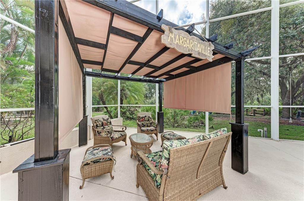 Plenty of space for your outdoor furniture - Single Family Home for sale at 7118 68th Dr E, Bradenton, FL 34203 - MLS Number is A4480398