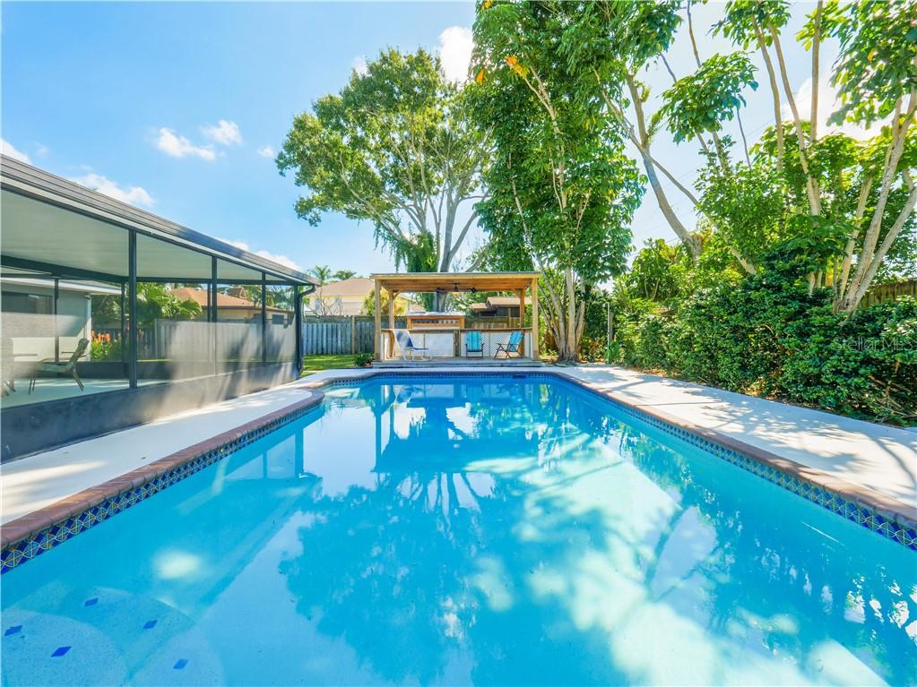 This huge 15x30 pool with built-in seating area was recently professionally refinished. - Single Family Home for sale at 2408 Riverside Dr E, Bradenton, FL 34208 - MLS Number is A4480609