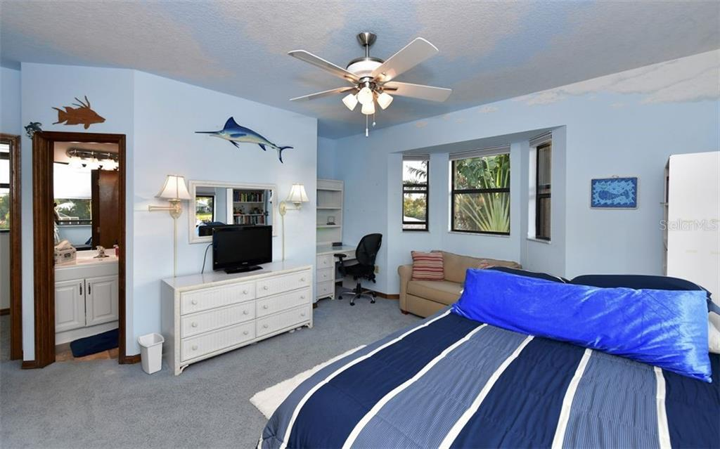 Bedroom 4 showing bathroom, desk area and bowed window area - Single Family Home for sale at 9219 Bimini Dr, Bradenton, FL 34210 - MLS Number is A4483083