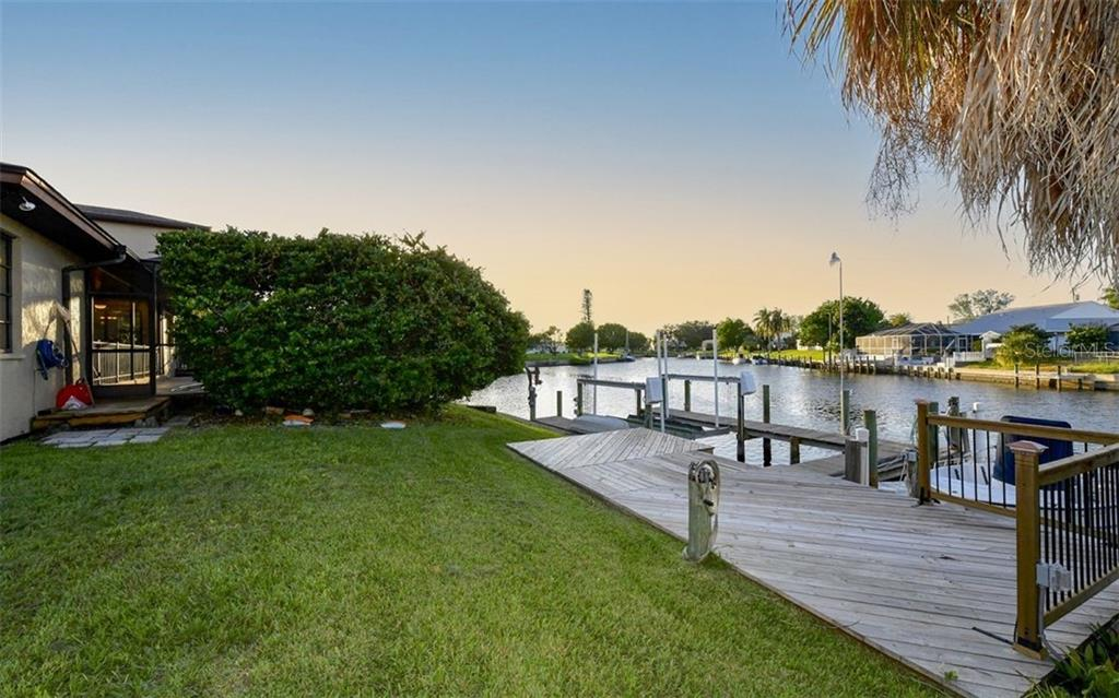 Deck and dock area to lanai entrance - Single Family Home for sale at 9219 Bimini Dr, Bradenton, FL 34210 - MLS Number is A4483083