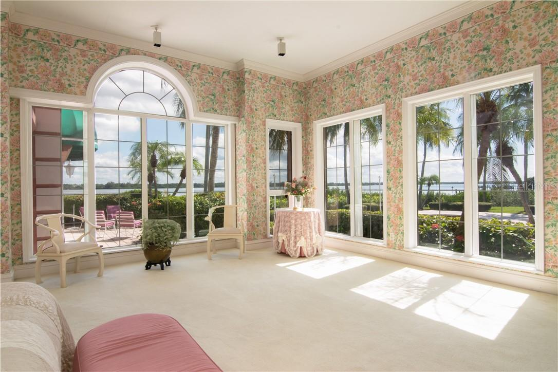 Master bedroom showing endless water views. - Single Family Home for sale at Address Withheld, Sarasota, FL 34242 - MLS Number is A4483403