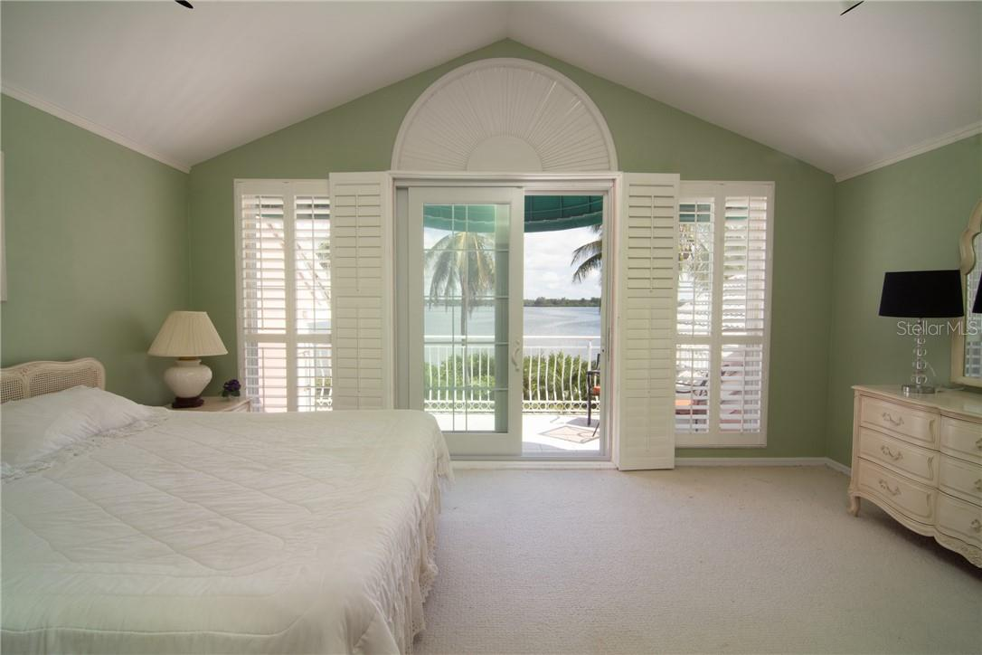 Second floor South bedroom with private balcony, and gorgeous water views. - Single Family Home for sale at Address Withheld, Sarasota, FL 34242 - MLS Number is A4483403