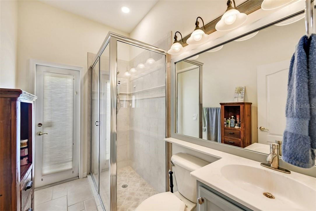 Guest bath can be accessed from outside/pool. Painted cabinets and framed mirror - Single Family Home for sale at 7832 Panther Ridge Trl, Bradenton, FL 34202 - MLS Number is A4483837