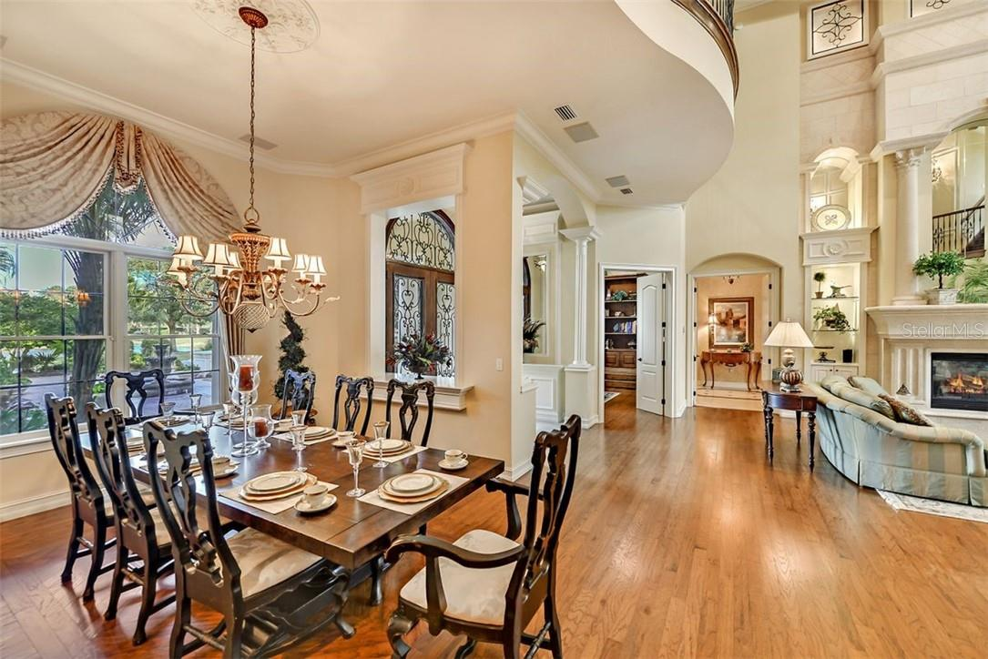 Another view of this charming dining room off from the foyer & double door study & double door master vestibule. - Single Family Home for sale at 8263 Archers Ct, Sarasota, FL 34240 - MLS Number is A4483993