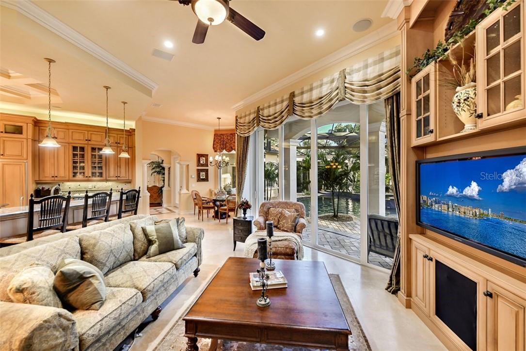 The family room is an easy spot to watch a game after some lunch. - Single Family Home for sale at 8263 Archers Ct, Sarasota, FL 34240 - MLS Number is A4483993