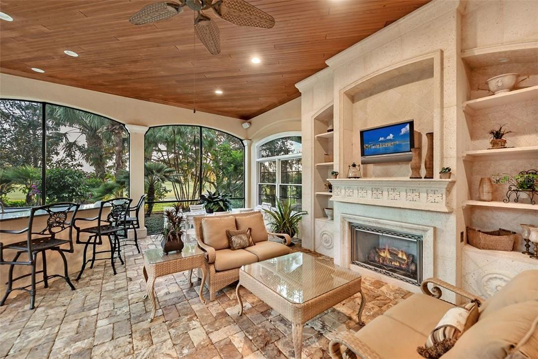 A COZY FIREPLACE TO KEPP YOU WARM AT NIGHT WHILE YOU WATCH A MOVIE - Single Family Home for sale at 8263 Archers Ct, Sarasota, FL 34240 - MLS Number is A4483993