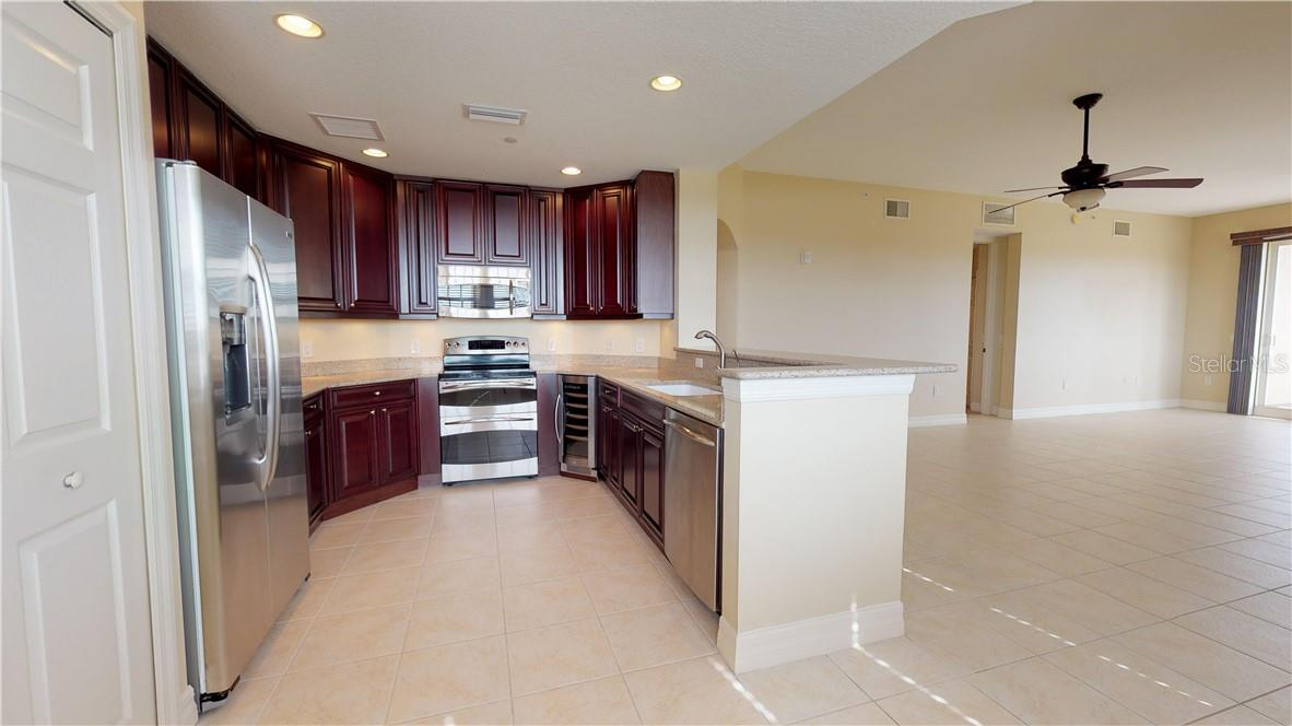 Gorgeous cherry wood cabinets and stainless steel appliances - Condo for sale at 5591 Cannes Cir #506, Sarasota, FL 34231 - MLS Number is A4484243