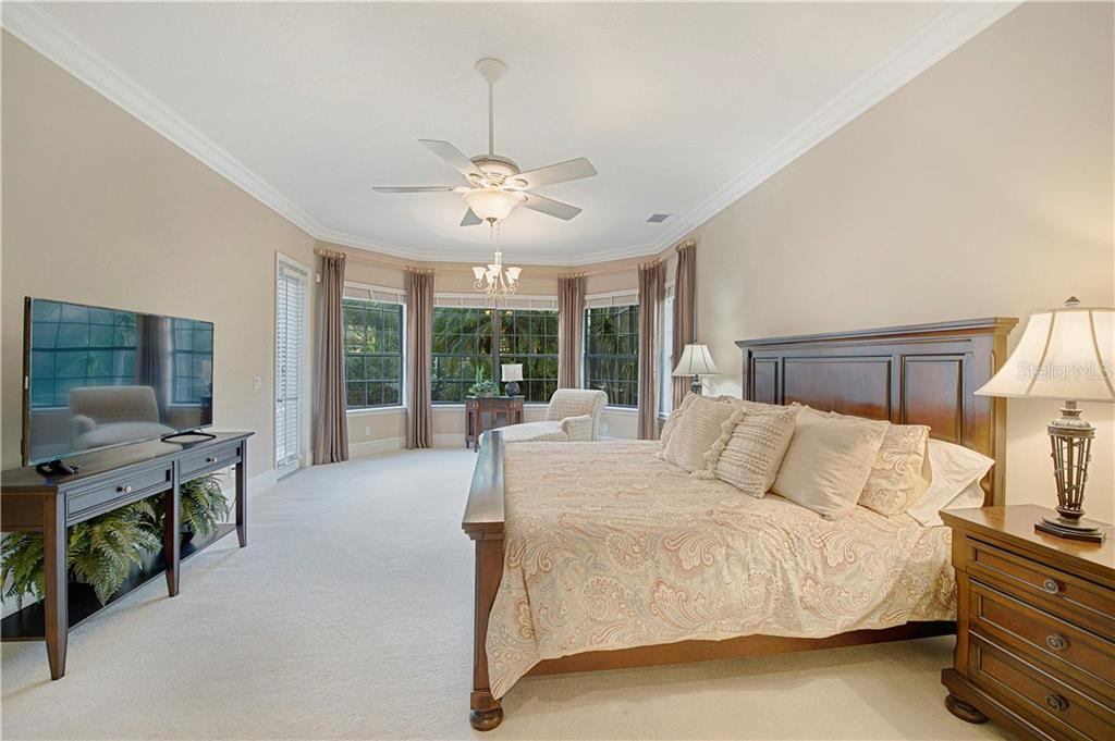 Master bedroom with large bay windows overlooking the preserve - Single Family Home for sale at 13223 Palmers Creek Ter, Lakewood Ranch, FL 34202 - MLS Number is A4484826