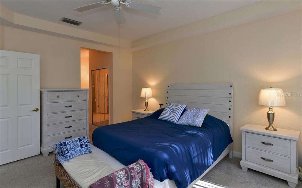 Master bedroom with tray ceiling. - Villa for sale at 4812 Lakescene Pl, Sarasota, FL 34243 - MLS Number is A4486070