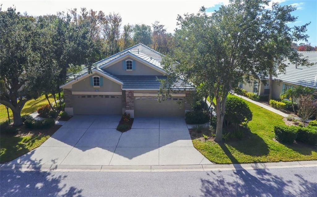 Aerial front view of villa. - Villa for sale at 4812 Lakescene Pl, Sarasota, FL 34243 - MLS Number is A4486070
