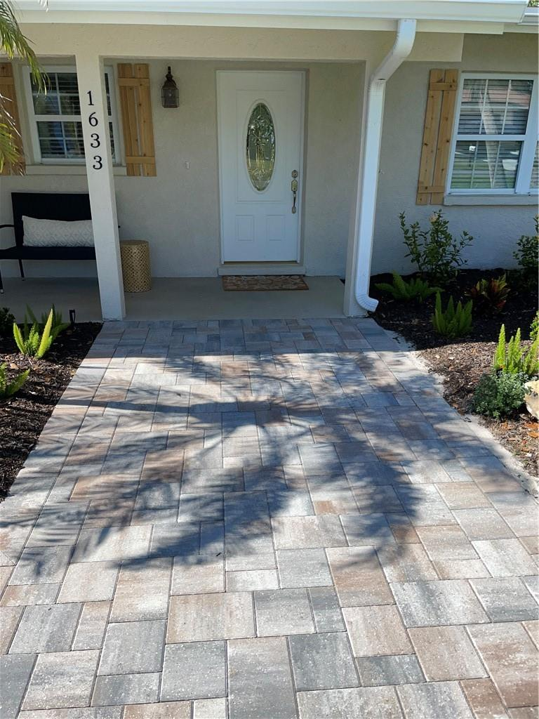 Front entranceway with paver walkway. - Single Family Home for sale at 1633 Ridgewood Ln, Sarasota, FL 34231 - MLS Number is A4496839