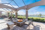 Expansive lanai overlooking pool and lake - Single Family Home for sale at 16318 Daysailor Trl, Lakewood Ranch, FL 34202 - MLS Number is A4170081
