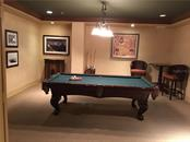 There is a Business Suite with lounge chairs, computer access, billiards, TV, for residents' use. There also is a separate