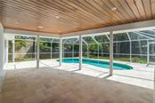 Cypress ceilings and terrazzo paver lanai. - Single Family Home for sale at 5115 Dewey Pl, Sarasota, FL 34242 - MLS Number is A4177178