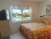 Bedroom with view of the pool - Condo for sale at 100 73rd St #204a, Holmes Beach, FL 34217 - MLS Number is A4185340