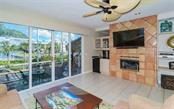 Family Room to Kitchen - Single Family Home for sale at 3380 Gulf Of Mexico Dr, Longboat Key, FL 34228 - MLS Number is A4185604