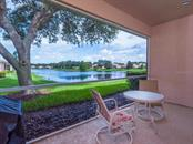 Covered lanai with lake views - Single Family Home for sale at 4294 Reflections Pkwy, Sarasota, FL 34233 - MLS Number is A4185695