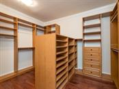 Dream closet with custom cabinets and shelving plus and island of shelving! - Single Family Home for sale at 1884 Grove St, Sarasota, FL 34239 - MLS Number is A4189365