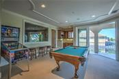 Pool table stays!! Bring your friends up here and be ready to be wowed. The wet bar has a natural light window and the views from the balcony are incredible! - Single Family Home for sale at 548 Fore Dr, Bradenton, FL 34208 - MLS Number is A4196590