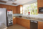 Clubhouse kitchen - Single Family Home for sale at 508 Marsh Creek Rd, Venice, FL 34292 - MLS Number is A4204933