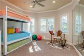 Exercise room with full floor to ceiling mirrors. - Single Family Home for sale at 8346 Farington Ct, Bradenton, FL 34202 - MLS Number is A4206244