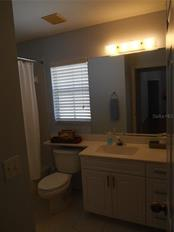 The guest bathroom offers a tub and shower combo with more great storage! - Condo for sale at 815 Montrose Dr #202, Venice, FL 34293 - MLS Number is A4206556