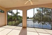 Lanai overlooking lake. - Condo for sale at 5242 Parisienne Pl #201bd30, Sarasota, FL 34238 - MLS Number is A4208770