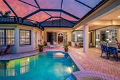 Reverse view showcases plenty of both covered and uncovered patio spaces for enjoying the sunshine and entertaining your guests! - Single Family Home for sale at 13223 Palmers Creek Ter, Lakewood Ranch, FL 34202 - MLS Number is A4408290