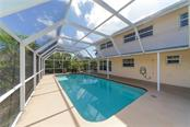 Bonus room first level - Single Family Home for sale at 5591 Cape Aqua Dr, Sarasota, FL 34242 - MLS Number is A4411099