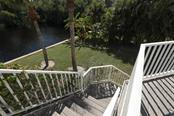 Stairs from rear of house - Single Family Home for sale at 13114 Via Flavia, Placida, FL 33946 - MLS Number is A4416122