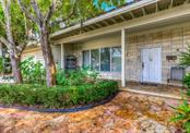 The flagstone walk way leads to the 6 x 31 front porch. - Single Family Home for sale at 1509 Flower Dr, Sarasota, FL 34239 - MLS Number is A4421898
