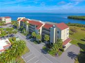 The mangroves are home to many bird species, the bay has jumping mullet/dolphin/manatees, and the lawn is home to your fellow residents walking their dogs or going for a relaxing stroll. - Condo for sale at 4700 Gulf Of Mexico Dr #305, Longboat Key, FL 34228 - MLS Number is A4422164