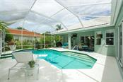 Pool area looking toward lanai and master bedroom, living room and casual dining - Single Family Home for sale at 6161 Varedo Ct, Sarasota, FL 34243 - MLS Number is A4422883