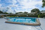 Community pool area. - Villa for sale at 3434 Medford Ln #1110, Sarasota, FL 34239 - MLS Number is A4422897