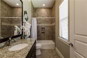 Ensuite Bath for Bedroom 2 - Single Family Home for sale at 20 Blake Way, Osprey, FL 34229 - MLS Number is A4423645
