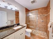 Guest bathroom. - Single Family Home for sale at 2558 Oneida Rd, Venice, FL 34293 - MLS Number is A4428145